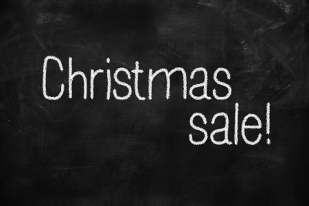 Christmas Sale handwritten with white chalk on a blackboard photo