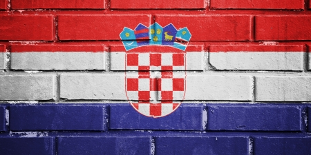 Bandera de Croacia en textura de la pared de ladrillo photo