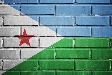 djibouti: Djibouti flag on the brick wall Stock Photo