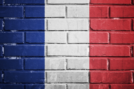 France flag on the brick wall photo
