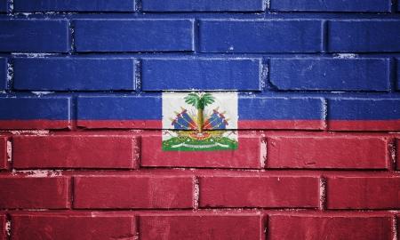 Haiti flag on texture brick wall photo