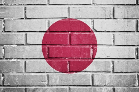 Japan flag on the brick wall photo