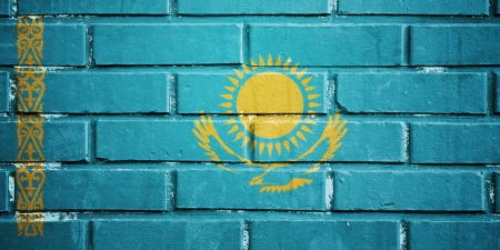 Kazahstan flag on texture brick wall Stock Photo