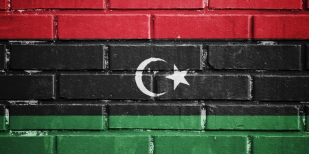 Libya flag on texture brick wall photo