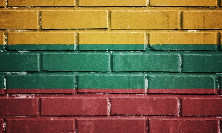 Lithuania flag on texture brick wall photo
