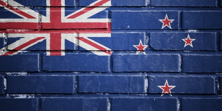 New Zealand flag on texture brick wall photo