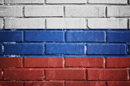 Russia flag on the brick wall photo