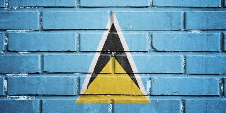 saint lucia: Saint Lucia flag on texture brick wall