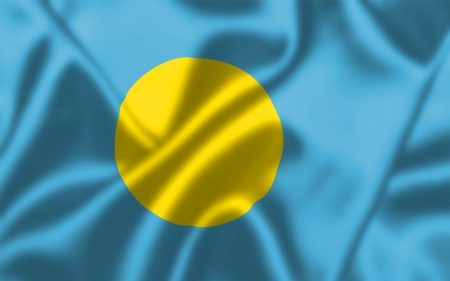 Palau flag blowing in the wind. Background texture. photo