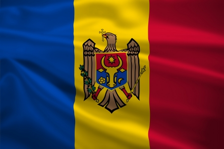 Moldova flag blowing in the wind. Background texture. photo