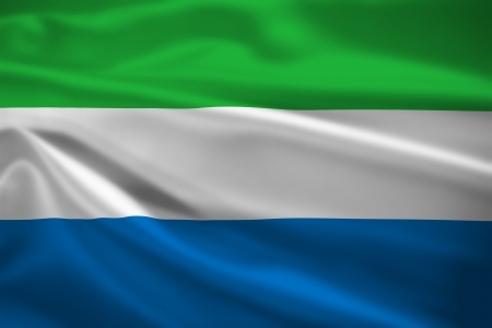 Sierra Leone flag blowing in the wind. Background texture. photo