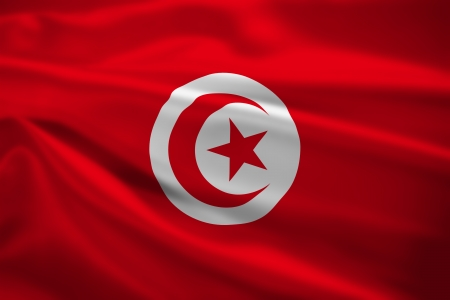 Tunisia flag blowing in the wind. Background texture. photo