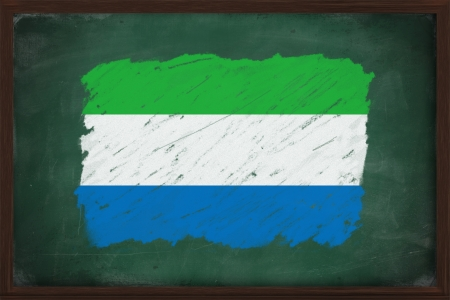 Sierra Leone flag painted with color chalk on old blackboard photo