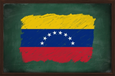 Venezuela flag painted with color chalk on old blackboard photo
