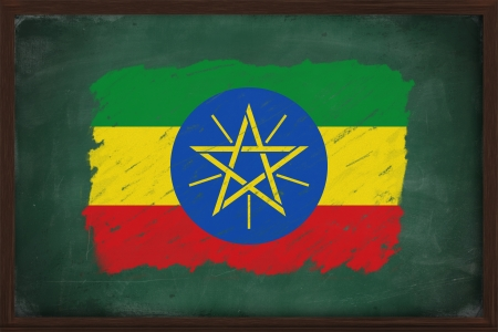 Ethiopia flag painted with color chalk on old blackboard photo