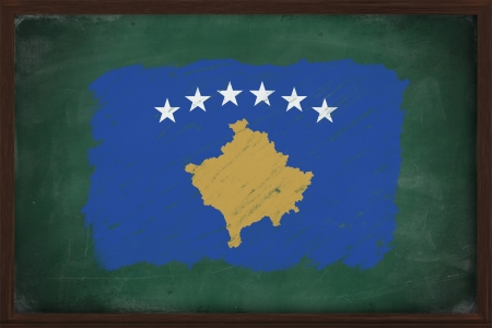Kosovo flag painted with color chalk on old blackboard photo