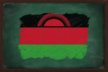 malawi flag: Malawi flag painted with color chalk on old blackboard