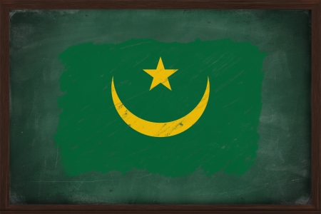 Mauritania flag painted with color chalk on old blackboard photo