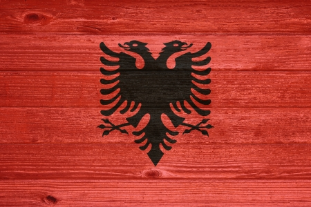 albanian: Albania Flag painted on old wood plank background