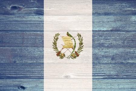 Guatemala Flag painted on old wood plank background photo