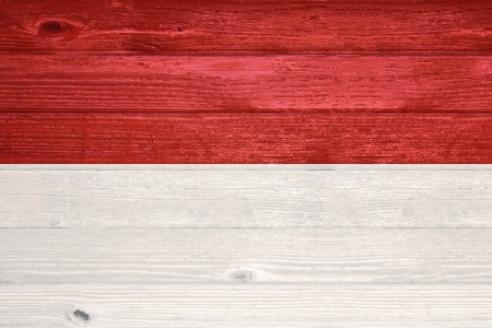 Indonesia Flag painted on old wood plank background photo