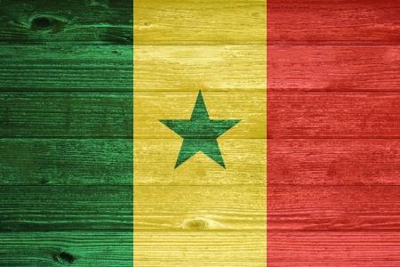 Senegal Flag painted on old wood plank background photo