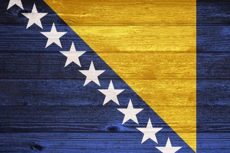 bosna: Bosnia and Herzegovina Flag painted on old wood plank background