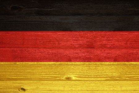 Germany Flag painted on old wood plank background photo