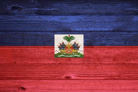 Haiti Flag painted on old wood plank background photo