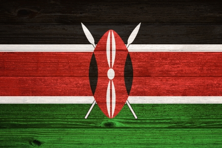 Kenya Flag painted on old wood plank background photo