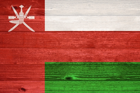 oman background: Oman Flag painted on old wood plank background Stock Photo