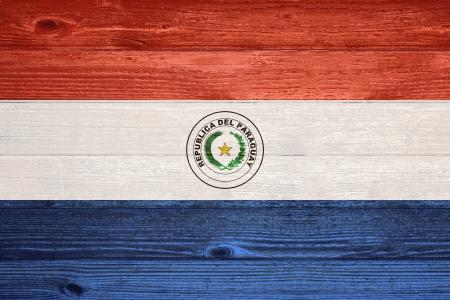 Paraguay flag: Paraguay Bandera pintada en el viejo fondo de madera del tabl�n Foto de archivo