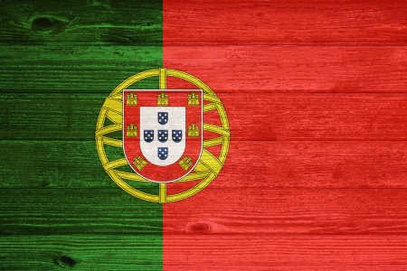 Portugal Flag painted on old wood plank background photo
