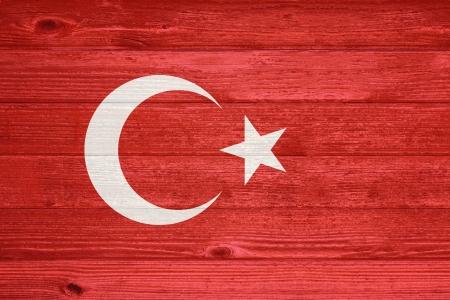Turkey Flag painted on old wood plank background photo