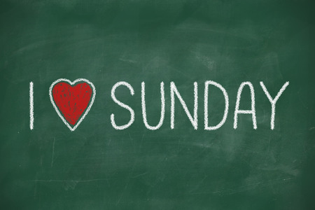 sunday: I love Sunday phrase handwritten on a school blackboard