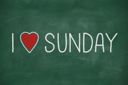 sunday: I love Sunday phrase handwritten on a school blackboard