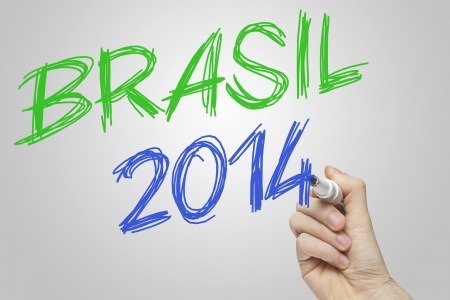 Hand writing with a green and blue marker on a whiteboard - Brazil 2014