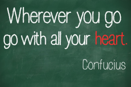 wherever: famous Confucius quote Wherever you go, go with all your heart handwritten on a blackboard