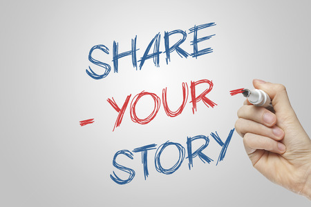 Share your story written on a transparent board with a red and blue marker photo