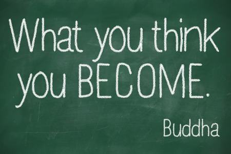 intention: famous Buddha quote What you think you become handwritten on blackboard Stock Photo