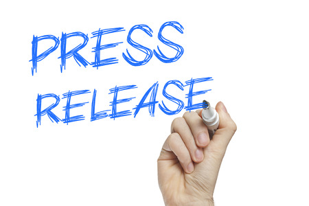 Hand writing press release on a white board - news concept Stock Photo