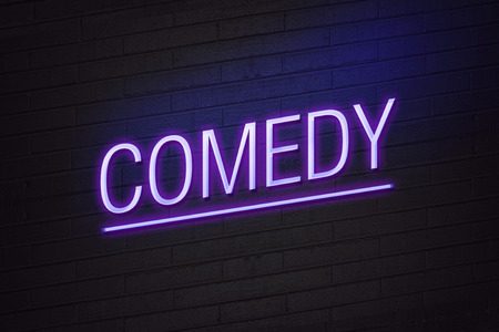 comedy: Comedy neon sign on wall Stock Photo