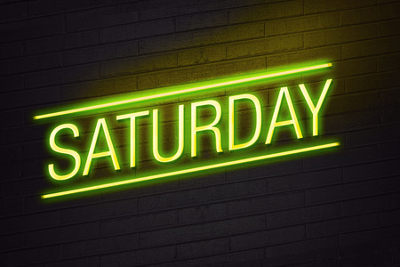 Saturday neon sign on club wall