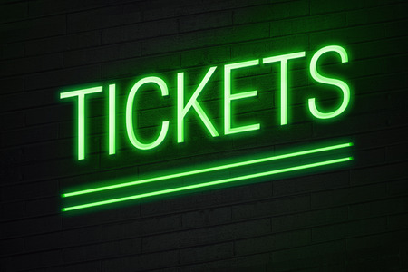 Green neon sign with tickets text on wall photo
