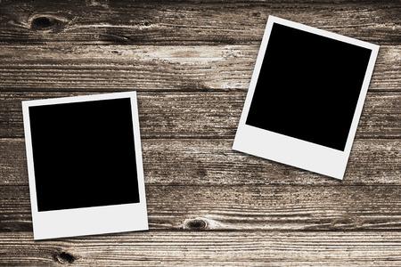two retro frames on wood texture photo
