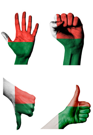 closed fist: hands with multiple gestures (open palm, closed fist, thumbs up and down) with Madagascar flag painted isolated on white