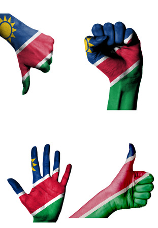 closed fist: hands with multiple gestures (open palm, closed fist, thumbs up and down) with Namibia flag painted isolated on white Stock Photo