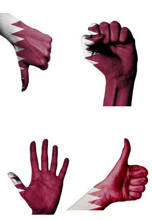 closed fist: hands with multiple gestures (open palm, closed fist, thumbs up and down) with Qatar flag painted isolated on white