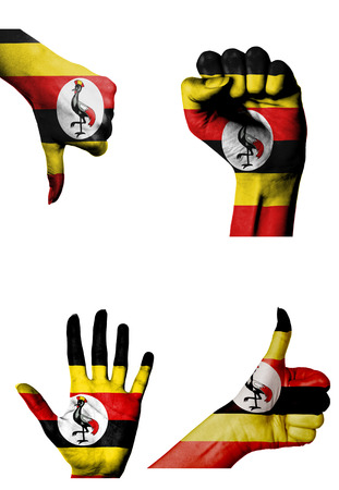 closed fist: hands with multiple gestures (open palm, closed fist, thumbs up and down) with Uganda flag painted isolated on white