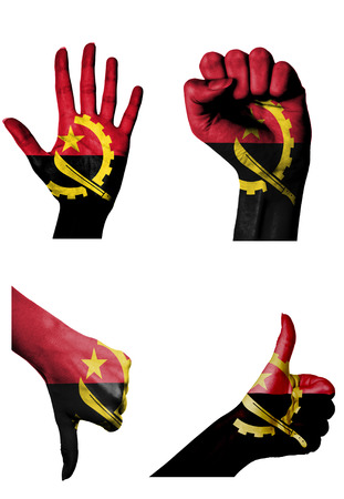 hands with multiple gestures (open palm, closed fist, thumbs up and down) with Angola flag painted isolated on white photo